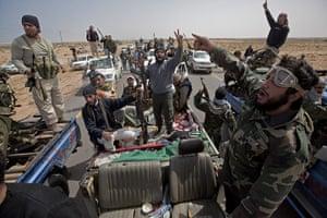 Sean Smith in Libya: Rebel soldiers move forward before having to retreat past Bregga
