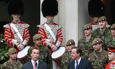 David Cameron Greets Governor Arnold Shwarzenegger At Downing Street