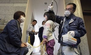 A Japanese girl is screened for radiation in Iitate, 40km from the damaged Fukushima nuclear plant