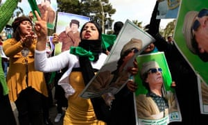 Gaddafi supporters stage a rally in Tripoli