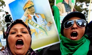 Gaddafi supporters chant slogans during a rally in Tripoli