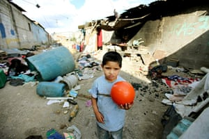Guatemala Toybox Charity: A boy holds a ball in a Guatemala rubbish dump