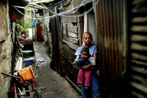 Guatemala Toybox Charity: Children stand in the doorway of their home