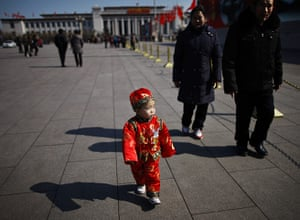 from the agencies: A child in traditional Chinese dress visits Tiananmen Square