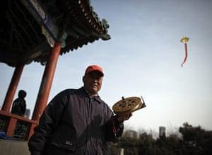 from the agencies: A man flies a kite in Ritan park