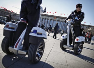 from the agencies: Police ride two-wheel electronic vehicles while patrolling Tiananmen Square