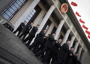 from the agencies: Security guards march out the Great Hall of the People