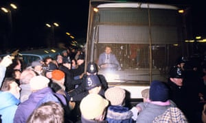 Flash point ... journalists are bussed through the picket line into the Wapping plant in 1986