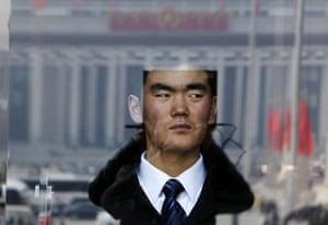NPC in Beijing: A security officer keeps watch