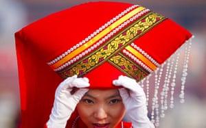 NPC in Beijing: Stewardess adjusts  her hat