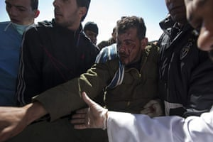 Sean Smith in Libya: A Libyan man who was injured in clashes arrives at Ras Lanuf hospital