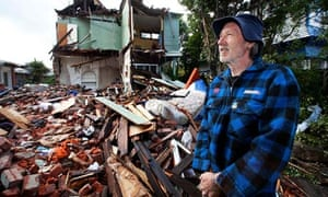 Mike Barthelmeh inspects his earthquake-damaged property in central Christchurch