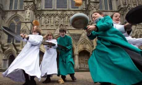 Pancakes are tossed by choristers at Salisbury Cathedral