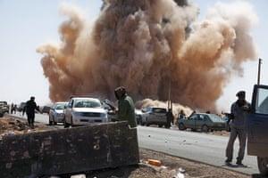 Sean Smith: An airstrike by forces loyal to Muammar Gaddafi near a rebel checkpoint