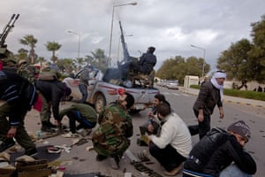 Sean Smith: 8 March: Rebel fighters fire at a plane in the town centre of Ras Lanuf