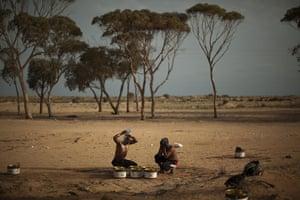 Libya Ras Jdir: Men from Bangladesh wash themselves in a refugee camp in Ras Jdir