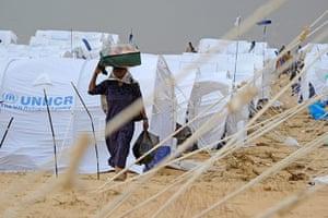 Libya Ras Jdir: A refugee walks through the Choucha refugee camp in Ras Jdir