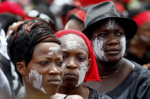 Ivory Coast violence: Anti-Gbagbo protesters look on during a demonstration in Abidjan