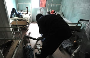 Ivory Coast violence: Injured people receive care in a hospital in Abidjan's Treichville