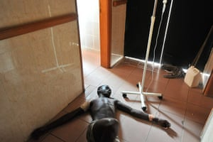 Ivory Coast violence: A wounded man receives medical care at a hospital in Treichville