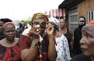Ivory Coast violence: Women's organiser Betty Nguessan grieves during a march of mourning