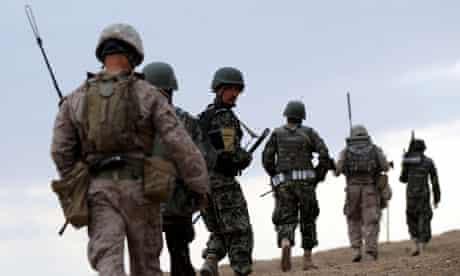 Afghan and American soldiers on patrol in Afghanistan