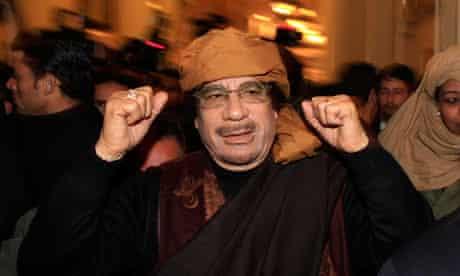 Libya's leader Muammar Gaddafi arrives to give television interviews at a hotel in Tripoli, Libya