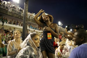 from the agencies : A woman sings during a carnival parade at the Sambadrome