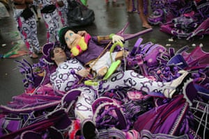 from the agencies : A samba school dancer rests after a carnival parade at the Sambadrome