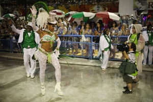from the agencies : A Mangueira samba school dancer poses for a photographer
