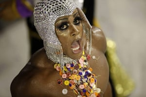 from the agencies : A member of the Salgueiro samba school parades in the Sambadrome