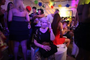 from the agencies : A woman takes a break at a gay Carnival celebration