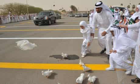 Saudi children run after doves in riyadh