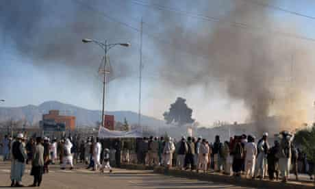 Smoke rises from the UN compound in Mazar-e-Sharif, Afghanistan