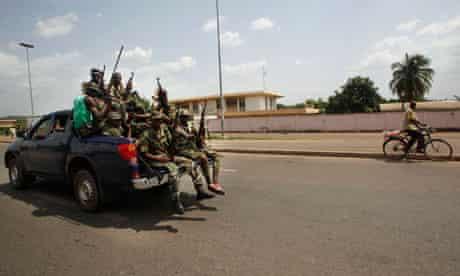 Forces loyal to Alassane Ouattara patrol the Ivory Coast city of Yamoussoukro