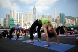 24 hours in pictures: Yoga followers take part in a 'Yogathon' event in Hong Kong