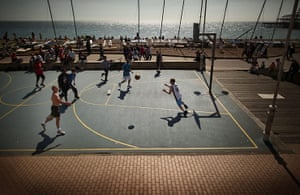 24 hours in pictures: A basketball match takes place on the sea front, Brighton, UK