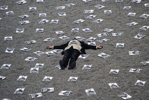 24 hours in pictures: A man lies on Sunflower Seeds installation by Ai Wewei at the Tate Modern