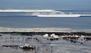 Japan disaster 1 month on: An oncoming tsunami strikes the coast in Natori City, Miyagi Prefecture