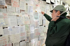 Japan disaster 1 month on: messages appealing for information on missing people in Natori