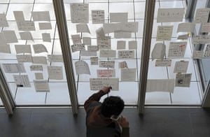 Japan disaster 1 month on:  notes at Natori City Hall, appealing for missing loved ones