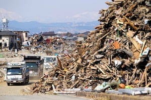 Japan disaster 1 month on: Trucks help to remove the debris left over from the disaster