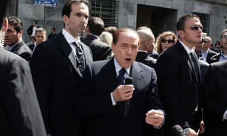 Silvio Berlusconi addresses supporters outside court