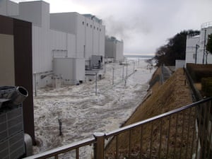 Fukushima disaster: March 11: The access road at the compound of Fukushima plant is flooded