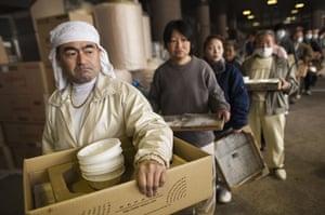 Fukushima disaster: 9 April:  Earthquake victims line up for food at evacuation shelter