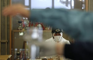 Fukushima disaster: 12 April: A member of Japan's Self-Defence Force watches test for radiation