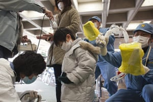 Fukushima disaster: 5 April:  Japanese people undergo a screening for possible radiation