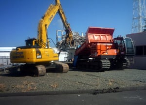 Fukushima disaster: 6 April: A remote controlled unmanned crane loads rubble