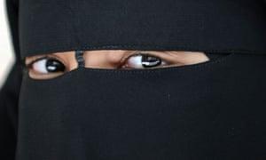 A Muslim woman in a niqab.