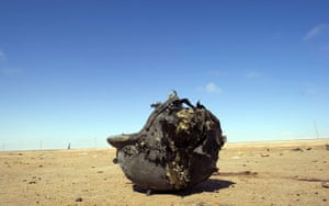 Ajdabiya, Libya : Helmet belonging to a killed fighter lies on the ground, Ajdabiya